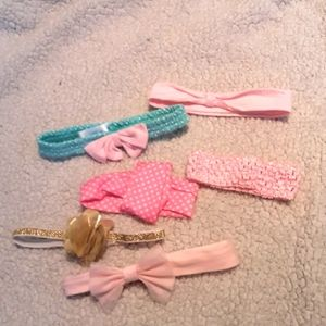 6 children's stretchy  headbands pinks mostly
